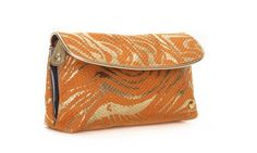 """Stephanie Johnson 'Katie' Folding Clutch Cosmetic Case - Palm Desert Orange by Stephanie Johnson. $40.00. Two clear zip pockets. Sophisticated navy liner. Trim and tab zipper pulls in brilliant gold. 7 3/4"""" L x 2 1/4"""" W x 4 1/2"""" H. Swirls of metallic gold zebra printed on tangerine canvas. This delightful case unfolds to reveal two clear zip pockets, putting your precious cargo easily on display. Folds into a charming clutch shape, and secures with a snap closure.   swirls..."""