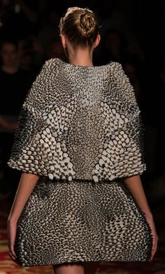 from Iris van Herpen's spring 2013 couture. for this piece she worked with with Neri Oxman of MIT media lab and 3D printer Stratasys