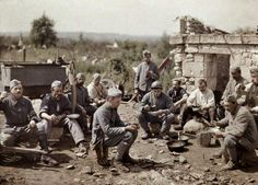 French soldiers of the 370th Infantry Regiment eat soup during the battle of the Aisne in 1917.