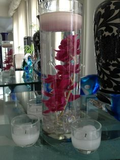 DIY submerged orchids :  wedding centerpiece diy diy centerpiece pink reception submerged flowers AoI9eLfCAAAl3YO