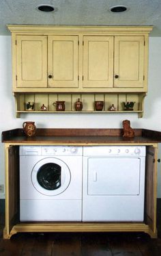 Custom yellow laundry room built in. Awesome