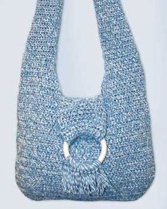 Crochet a hip hobo bag with shoulder strap and ring accent. This hobo bag crochet pattern is easy, fun and creates the perfect size purse.