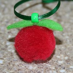 A cute apple necklace craft.  Students can make it for themselves or for a teacher.