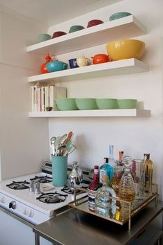 I really think my landlord should consider this kind of shelving instead of the awkward cabinet she has hanging.