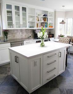 white cabinets, grey tile, and grey and tan backsplash
