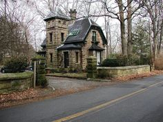 1875 Gatehouse - 84 Old Beach Rd, Newport, RI. Charming stone Swiss-style porter's Gatehouse Lodge built 1875 by Dudley Newton. Renovated, period details, sun porch, stone wall, stone patios, beautifully landscaped private lot, walk to beach, town center, Bellevue. Falls River granite.