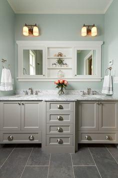 Master bathroom with double vanity, marble countertop, mint walls, slate tile flooring   Fluidesign Studio