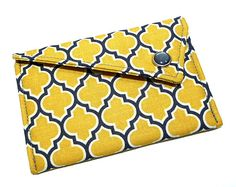 Card holder in yellow and grey lattice with pearl snap closure.    This card holder is the perfect little accessory. It is great for carrying