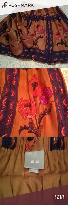 Lovely Details- Maeve skirt Mustard and indigo, floral and sequins. Pretty Maeve skirt with elastic waist, simple and easy to wear but can look quite dressed up. Fully lined, euc. Anthropologie Skirts