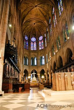 The interior of Notre Dame Cathedral in Paris, France is an inspiring atmosphere, whatever your religion may be