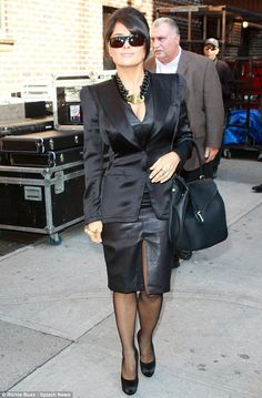 She means business: Salma Hayek strutted into The David Letterman Show on Wednesday in a figure-hugging leather dress and sexy satin suit jacket    The sultry star accessorised with some racy fishnet stockings, satin stilettos, a large leather handbag and a chunky Yves Saint Laurent necklace featuring a large gold padlock.
