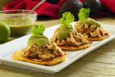 An absolutely delicious and flavorful, completely Paleo, green chili tostada recipe with an awesome topping. I used chicken, but would be excellent with pork.