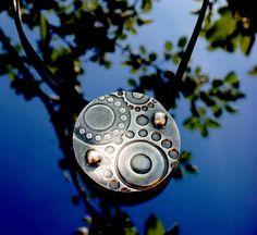 Silver pendant by Utukoru. Art clay silver 650, patina.
