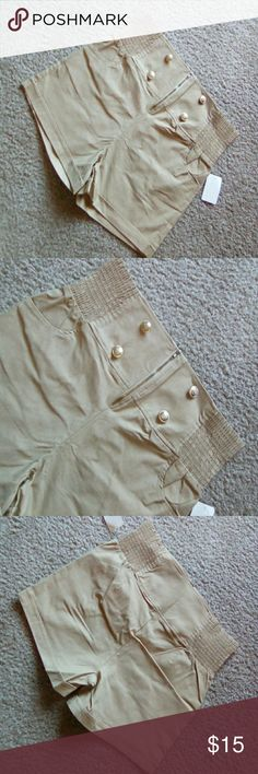 Plus size camel colored shorts Plus-size camel colored shorts In size 3x, size runs a bit small so I would say it's more like a 2X but has lots of stretch to it. Waist 33 inches Rise 13 inches Length 16 inches Brand new still with tags Shorts