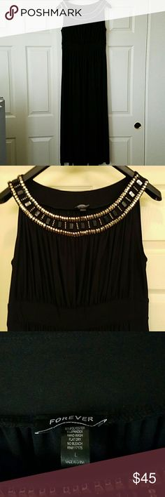 """🎉HP🎉 🎀Gorgeous Sleeveless Long Dress🎀 Beautiful black long sleeveless dress. Spandex and polyester. Used once only. In good condition. Length approx 53"""". Armpit to armpit approx 19"""". Forever Dresses"""