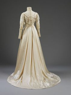 Wedding dress | Liberty & Co. Ltd. |1905 The dress fastens at the centre back with hooks and eyes. The lining is of cream ribbed silk and the bodice is lightly boned.