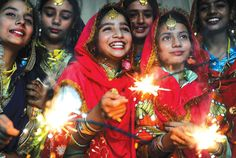 fyeahafrica:    TIME TO SPARKLE: Indian schoolgirls share a light moment as they play with sparklers at a celebration of the Festival of Lights in Amritsar.