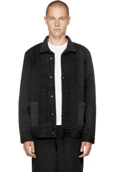 Long sleeve faded denim jacket in black. Felted cotton and wool-blend trim in grey throughout. Spread collar. Button closure and pleats at front. Patch pockets and blue logo flag at waist. Single-button barrel cuffs. Buttoned cinch tabs at back hem. Tonal hardware. Tonal stitching.