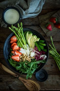 salad bowl with asparagus and walnuts