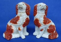 PAIR OF ANTIQUE STAFFORDSHIRE SEATED SPANIELS - C.1860