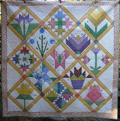 Grandma's Garden. a 30's repro quilt with embroidered words of wisdom.
