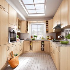 Small kitchen extension with sky light, wooden cabinetry, granite worktops and green accessories