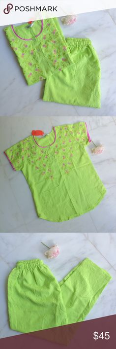"""NEW Embroidered PJ Set NEW Embroidered PJ Set, size M, lime green crinkle fabric w/green, purple, peach flower embroidery, two clear buttons, pink satin hem on sleeves & neck, elastic waist, pocket on top, NEW w/tags.                                                     Top: between shoulders 15"""", sleeves 6"""", neck 7"""", across bottom 21"""", length 25.5"""", 5"""" pocket                       Bottoms: waist 28"""", length 40"""" Ankita Intimates & Sleepwear Pajamas"""