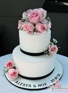 Elegant Wedding Cake with fresh flowers ... www.facebook.com/Cynthias.Custom.Cakes