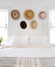 hanging my hats above the bed to act as both storage and decor above the headboard.