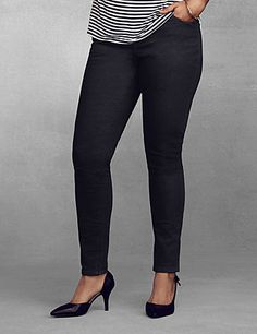Genius Fit black skinny jean uses the power of LYCRA® dualFX denim for a flattering fit that stays true to your shape and never stretches out. Ultra-trendy and curve-hugging silhouette combines the comfort of leggings with classic denim details like five-pocket design, button & zip fly closure and belt loops. Wear them with your favorite top and killer heels for a fashion-forward ensemble. Mid rise.  Available in Petite and Tall sizes. <br /> <br /> <em ></em> lanebryant.com