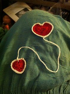 Crochet heart bookmark in red and white thread