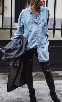 denim shirt and ripped jeans.