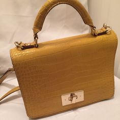 Kate Spade yellow crocodile cross body purse Hey Guys this is a Kate Spade cross body bag. I wore it about 3 times and it is in great condition. I also received plenty of compliments on it. This bag was seen on Jessica Alba also kate spade Bags Crossbody Bags
