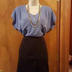 Double pocket zip-front blouse Cute loose-fitting blouse that goes great with a pencil skirt for the office. Color is somewhere near violet (blue with purple undertones). Yellow Chair Tops Blouses