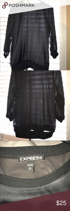 Express Black Top Xs 98% Polyester, 2% spandex Brand New without tag express Black loose top, nice for evening occasions $39.90 + tax retail price. Express Tops Blouses