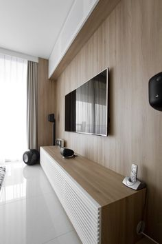 AO Studios_Bespoke Entertainment Console with Samsung Smart TV complete with Bowers Wilkins for the Natura Loft Apartment, SingaporeCurtain side wall detail Earth tones Architect's Home in Singapore: Natura Loft Apartment by AO StudiosNatura Loft Apartm Room Design, Interior, Living Room Cabinets, Apartment Interior, Minimalist Living Room, House Interior, Loft Apartment, Interior Design, Living Room Tv Wall