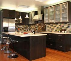 Love the dark wood in this kitchen
