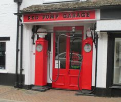 Avery Hardoll petrol pumps outside a disused garage in Buckinghamshire, March 2015.
