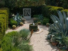 A simple fountain placed at the intersection of two paths provides a focal point