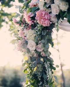 """""""Romantic, cascading spring florals for an @VivaBellaEvents wedding chuppah! 
