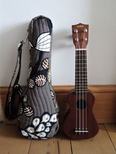 Love this design/fabric, but kinda feel like it's a little pricey.... Pocket ukulele gig bag in brown/black & white plant by IvyArch. $71.50, via Etsy.