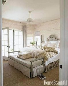 """White & Sage Bedroom – """"The master bedroom has a wild sage color on the painted bench and again on the bed,"""" designer Ginger Barber says. """"I love it against crisp white linen and whitewashed walls."""