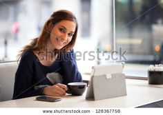 Happy Young Woman Using Tablet Computer In A Cafe Stock Photo 128367758 : Shutterstock
