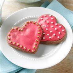 Chocolate-Raspberry Cutout Cookies Recipe -When my daughter, Katie, was 2, the juicy, ripe raspberries in my backyard inspired me to create this cutout cookie. It's become a mother-daughter tradition to pick the raspberries, choose the cutter shapes, cut out the cookies and frost them. We treasure the hours we've shared in the kitchen creating not only delightful cookies, but lasting memories.—Cindy Beberman, Orland Park, Illinois