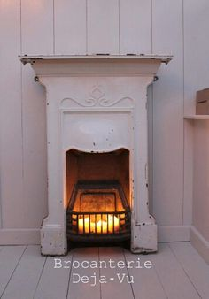 Worst case couldn't we have a precious little fireplace like this with just candles? Log Burner Fireplace, Cottage Fireplace, Candles In Fireplace, Cast Iron Fireplace, Small Fireplace, Bedroom Fireplace, Fireplace Mantle, Fireplace Surrounds, Fireplace Ideas