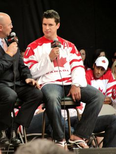 An Olympian deserves a better fate than being interviewed by Pierre McGuire. Crosby looks like he's either going to bolt or punch him in the face. (Also: Nice flip-flops, Sid.)