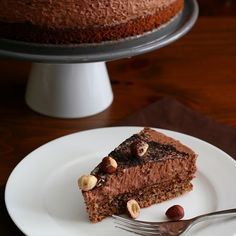 Chocolate Hazelnut Mousse Cake – Low Carb and Gluten-Free Recipe Desserts with hazelnut meal, whey protein powder, baking powder, salt, butter, Swerve Sweetener, hazelnut oil, large eggs, extract, stevia extract, almond milk, butter, cacao, large eggs, hot water, Swerve Sweetener, salt, cream of tartar, heavy cream, extract 4 grams per serving