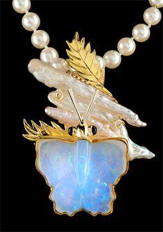 Opal Butterfly Enhancer:   18k yellow & green gold,   Brazilian opal: 55.80 carats;   biwa freshwater pearl: 22.33 carats;   amethyst .38 carats tcw.   Michael & Judy Wallace (Wallace Goldsmithing)