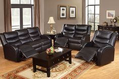 Black Bonded Leather Reclining Sofa and Loveseat Set.
