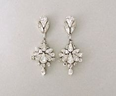 """Vintage Deco Style Swarovski Crystal Chandelier Earrings- On shiny Rhodium  silver plated settings adorned with stunning Swarovski Crystals. This style  is also offered in 18k Yellow Gold plating or 18k Rose Gold Plating.  Earrings are 3"""" in length and 1 1/4"""" across."""